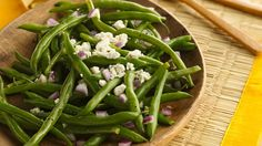 Turn simple green beans into a spirited side dish when you toss them with Greek cheese and vinaigrette.