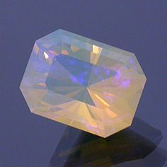 Clear Base, Bright Yellow Flashes and Mainly Blue Fire Barion Emerald-cut Opal Lambina Mines, Australia