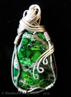 This is a sterling silver wire-wrapped Variscite pendant. It measures at 1 5/8 inches long and 7/8 of an inch at the widest point. Handmaden Designs  LLC. $125