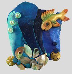 """Fish in the ocean are always fun to make! I used components from the CF """"Embellish Bits"""" kit """"Ocean Commotion"""" as the accents pieces (pearls, shell button fragments, sand dollar charms). #polymerclay #christifriesen #fish #ocean"""