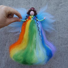Fairy felt, ornament fairy This handmade doll is made entirely out of wool using the art of needle felting. Doll is wool , arms wire-based , woolen hair. Fairy has a thread to hang it. Fairy is ornament. It is not toy. Is not suitable for children under 5 years, because there are free fibers