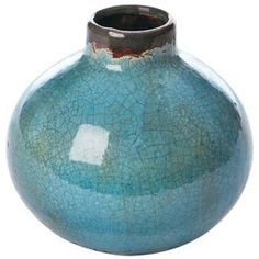 "Weathered ceramic vase with a crackle finish. Product: VaseConstruction Material: CeramicColor: BlueFeatures: Sleek styleDimensions: 6"" H x 7"" Diameter"