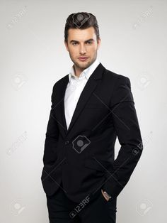 Fashion Young Businessman Black Suit Casual Poses At Studio Stock Photo, Picture And Royalty Free Image. Image 23190282.