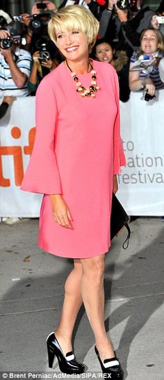 pretty in pink: knee length dress with bell sleeves; black pumps with white facing ... worn by Emma Thompson