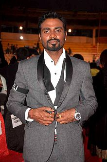 Remo D'Souza (born Ramesh Gopi on 2 April 1974) is an Indian dancer, choreographer, actor and film director. Although he is mainly involved in choreography, he has also contributed to other Indian film industries, mainly Bengali cinema. He was also seen as judge in the show Jhalak Dikhhla Jaa in 2010 along with Indian actresses Madhuri Dixit and Malaika Arora Khan