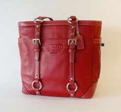 red leather Coach shoulder bag - this thing holds every. thing.