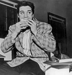 Elvis Presley, at a lunch counter sit-in. He doesn't get the point, but he's dead now.