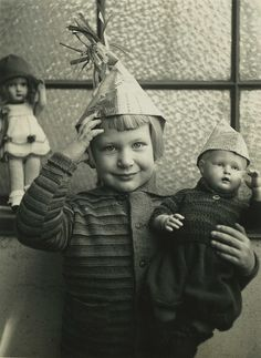 Group Portrait - vintage (Germany) photo of a little girl and her dolly, ready for a party.