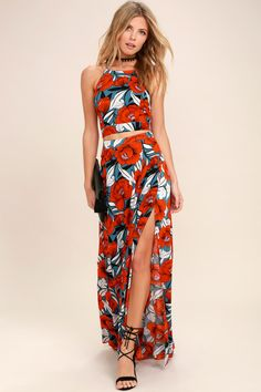 Get in touch with your flirty side in the Back to Your Roots Red Floral Print Two-Piece Maxi Dress! A floral print two-piece dress with a crop top and maxi skirt.