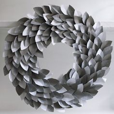 Paper wreath DIY! So gonna take out my scrapbook papers and do this!http://obviouslysweet.com/blog/2012/08/paper-wreath/#