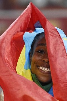 Ethiopia's Almaz Ayana is all smiles after winning the final of the women's 5000 metres