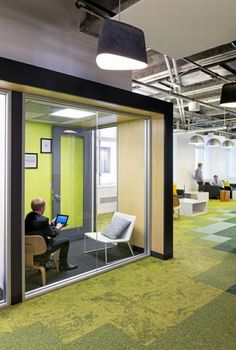modern office furniture at lightning casual green glass wall area