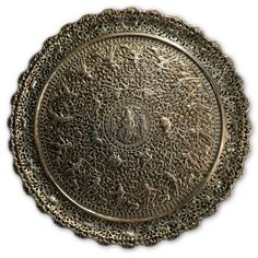 This large silver tray, of circular form, is ornamented with chased and repousse depictions of villagers rejoicing around Krishna, on a ground of scrolling foliate. The tray stands on four zoomorphic feet, the rim pierced and cast. The central medallion shows Krishna dressed in fine robes and wearing his peacock plume crown. To Krishna's side is a cow and a snake winds up his leg. Two cow herders flank Krishna. Female Cow, Joseph, Krishna Janmashtami, Large Tray, Silver Trays, Colonial, Classical Art, Gold Glass, Art Object