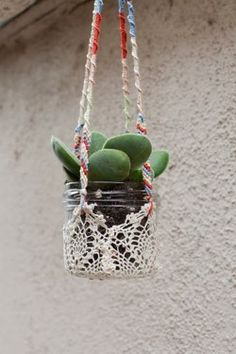 bohemiangardens:  wrap an old doiley around a jar and hang!