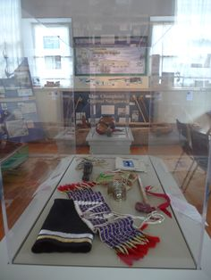 """""""From the Traditional Sources, Contemporary Visions"""" - Invitational Group Art Exhibit, June through October 2014. Wampum Belt, Silverwork by Paul Rene Tamburro, Beadwork by Michael Descoteaux. Soapstone Pipes by Fred Wiseman and Roger Longtoe Sheehan."""