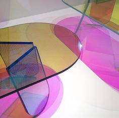 Patricia Urquiola's delightfully iridescent Shimmer coffee tables for Glas Italia change color as you move around the piece.