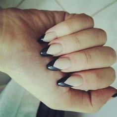 Almond nails with nude and black nail polish