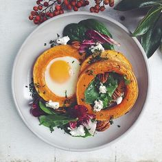 """Egg In A Hole Butternut Squash Rounds w/ Greens Feta & Pecans by the always creative @thedaleyplate for #breakfast.Get 100 ideas & #recipes like this from the Breakfast Eggs Feed (edited by @kevmasse) on our WEBSITE link in profile.  #sunday #brunch #homecooking #eatrealfood #eggs Remember to share your cooking baking and drink making by tagging """"#feedfeed @thefeedfeed"""" for a chance to be featured here and on our site! by thefeedfeed #instagram"""