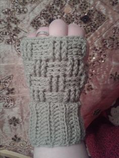 These basket weave stitch crochet fingerless mittens are easy and make a great gift.
