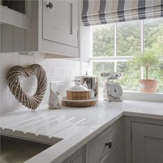 An inspirational image from Farrow and Ball, Pavillion Gray - 242 & Skimming Stone - 241
