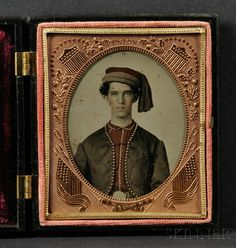"""Sixth Plate Ambrotype Portrait of a Union Zouave Soldier, with hand-tinted hat and shirt, in a black """"Union and Constitution"""" and 'The Nesting Birds"""" (Krainik 110, 168) Union case, (scattered specks of oxidation)."""