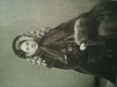 1860s lady in outerwear. American.