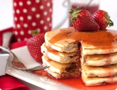 Chocolate Chip Pancakes with Strawberry Syrup  Makes about 8 medium pancakes.    1 cup granulated sugar  1 cup water  3 cup strawberries, hulled and chopped    1 3/4 cup flour  3 tsp baking powder  2 tbsp granulated sugar  1 tsp salt  1 1/4 cup milk  1 vanilla bean  1 egg  2 tbsp olive oil  3/4 cup chocolate chips