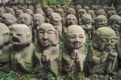 Stone statues grouped together on the grounds of Atago  Nembutsu-ji (temple) in Sagano district, Kyoto, Japan. Rich Iwasaki, photo shelter.com