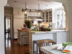 How to make a small cramped kitchen look like a million dollars!  This is an amazing space!