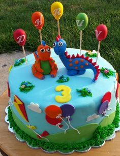 Dinosaur themed cake. Birthday cake with balloons