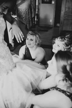 Bridesmaids help fluff the tulle at the bottom of Bride's wedding dress on wedding day / LEB is weekend wedding destination & barn event venue located in the Texas Hill Country / Photo: EffJay Photography