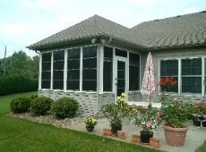 This sun room shows great landscaping around the room.  #sunroom, #landscaping, #summer, #green, #flowers