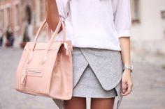 pale pink purse, gray skirt