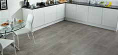 Reflecting the trend for larger floor tiles in poured concrete colors, Urbus' travertine inspired look is enhanced when coupled with a grout effect strip Karndean Flooring, Granite Flooring, Stone Flooring, Large Floor Tiles, Tile Floor, Concrete Color, Poured Concrete, Contemporary Kitchen Design, Stone Tiles