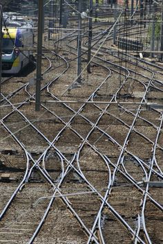 Overhead view of crisscrossing railway lines forming an intricate pattern on the ground - By stockarch.com <3