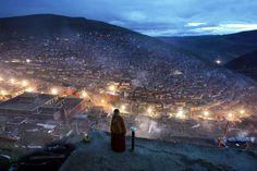 www.placeaholic.com wp-content uploads 2016 04 A-nun-stands-near-a-view-of-the-living-quarters-for-students-of-the-Seda-Larung-Wuming-Tibetan-Buddhist-Institute-in-Ganzizhou-southwestern-Chinas-Sichuan-province-on-October-1.-2006..jpg