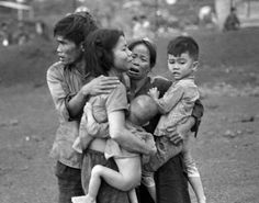 In this photo, South Vietnamese survivors of a mortar attack by government troops comfort each other. Later, after the government recaptured the post at Dong Xoai, the bodies of 150 civilians and 300 South Vietnamese soldiers were discovered.