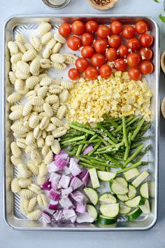 Sheet Pan Gnocchi with Summer Vegetables is an easy summer meatless dinner. One pan is all you need! Serves 4 in about 30 minutes. Veggie Recipes, New Recipes, Whole Food Recipes, Cooking Recipes, Healthy Recipes, Summer Vegetarian Recipes, Vegetarian Gnocchi Recipes, Summer Vegetable Recipes, Vegetable Meals