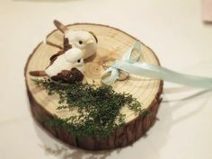 my handmade little bird ring pillow~  http://www.etsy.com/listing/99009824/handmade-of-wood-wedding-ring-cushion