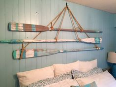 Hanging oars paddles on wall