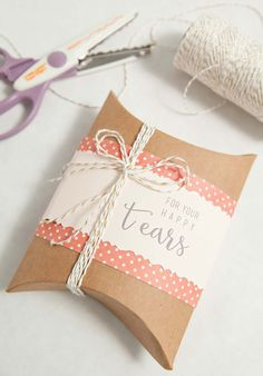 Give your loved ones a customized hankie for their happy tears, decorated in this charming pillow box.  Visit Fiskars.com for the tools and this tutorial.