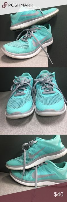Tiffany Blue Nike's Purchased these in hopes to start working out at the gym. Didn't use them as much as I thought. They are like new. Very minimal signs of wear. Tiffany blue with grey and white detailing. Super comfortable. Nike Shoes Athletic Shoes