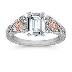 6.9mm x 4.8mm Emerald cut White Sapphire  Stand apart from the crowd with this striking 14 karat white and rose gold engagement ring.  Twenty-six round diamonds, at approximately .21 carat total weight, accent a vintage leaf motif that is as timeless as your love.  Add the center stone of your choice for a lovely ring that she will adore forever. Shown with a center stone Emerald Cut White Sapphire.