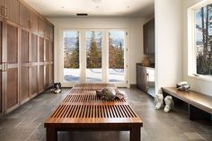 Contemporary Mud Room with travertine tile floors, Built-in bookshelf, Window seat, French doors