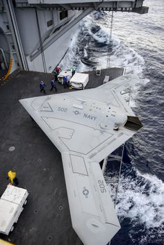 ATLANTIC OCEAN (Dec. 11, 2012) An X-47B Unmanned Combat Air System (UCAS) demonstrator aircraft is transported on an aircraft elevator aboard the aircraft carrier Harry S. Truman (CVN 75). (U.S. Navy photo courtesy of Northrop Grumman by Alan Radecki/Released)