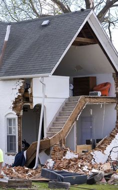 A view of a home after part of its exterior was destroyed after a tornado hit Thurman, Iowa April 15, 2012.