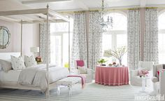 "The master bedroom in a Florida house is ""soft, subtle, and refined,"" designer Marshall Watson says. ""It invites light, air, and the silvery reflections from the water."" The focal point is the Lancaster bed from his Continental collection for Edward Ferrell + Lewis Mittman, inspired by the architecture of Georgian buildings he had seen in London. Curtains are in a Lee Jofa crewel on linen: ""It's great to take an unexpected texture like that into a tropical environment."""