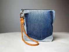A denim clutch bag made from vintage Calvin Klein jeans. Big enough to hold your wallet, cell phone, cosmetics, keys...Small enough to perfectly fit