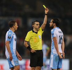 The referee Ovidiu Hategan shows the yellow card to Marco Parolo of SS Lazio during the UEFA Europa League quarter final leg one match between SS Lazio and RB Salzburg at Stadio Olimpico on April 5, 2018 in Rome, Italy. - 67 of 120