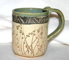 Ceramic Pottery Mug / Carved Flowers. $16.00, via Etsy.